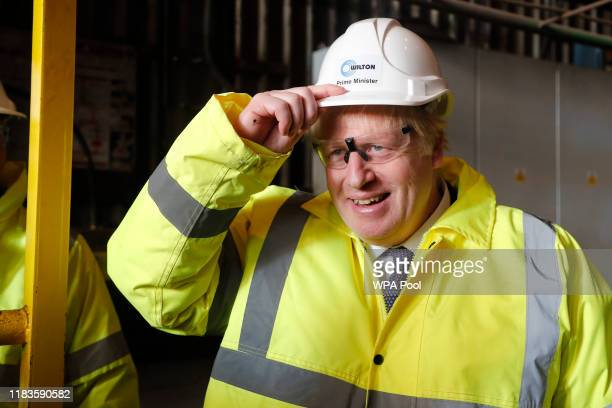 Prime Minister Boris Johnson wears a construction helmet with Prime Minister written on it during a visit to Wilton Engineering Services as part of a...