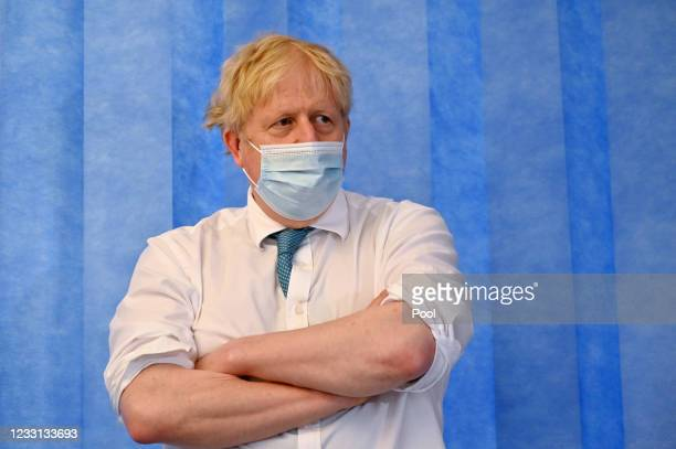 Prime Minister Boris Johnson wears a face mask as he visits Colchester hospital on May 27, 2021 in Colchester, United Kingdom.