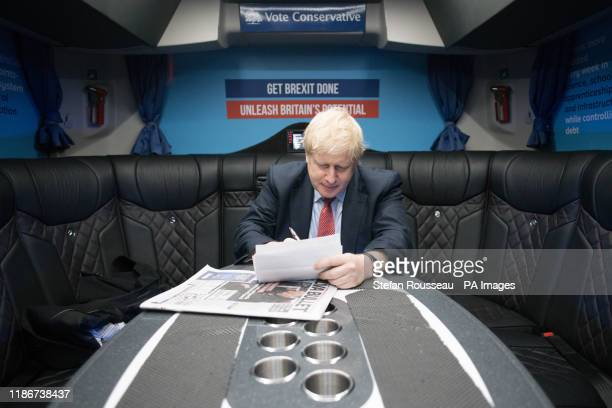 Prime Minister Boris Johnson, works in his campaign bus as he heads to the Kent Event Centre, Maidstone, while on the election campaign trail.