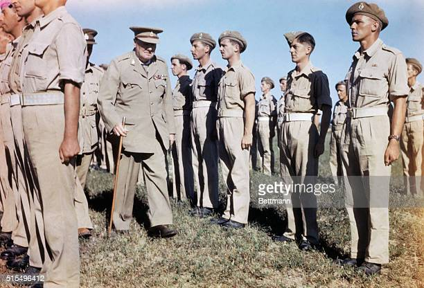 Prime Minister Churchill visiting Italy and inspecting troops.