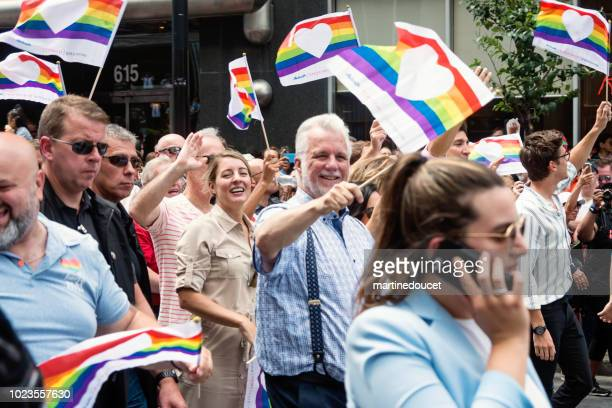 Prime Minister Couillard marching at the LGBTQ Pride Parade in Montreal street.
