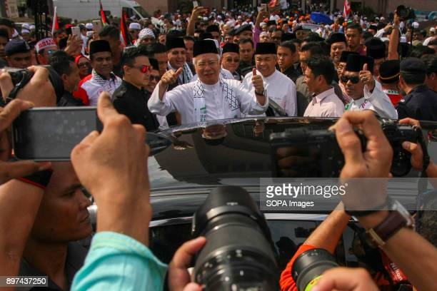 Prime Minister Datuk Seri Najib Razak seen leaving the solidarity rally Hundred of Malaysian people had gathered at Putrajaya Mosque to demonstrate...