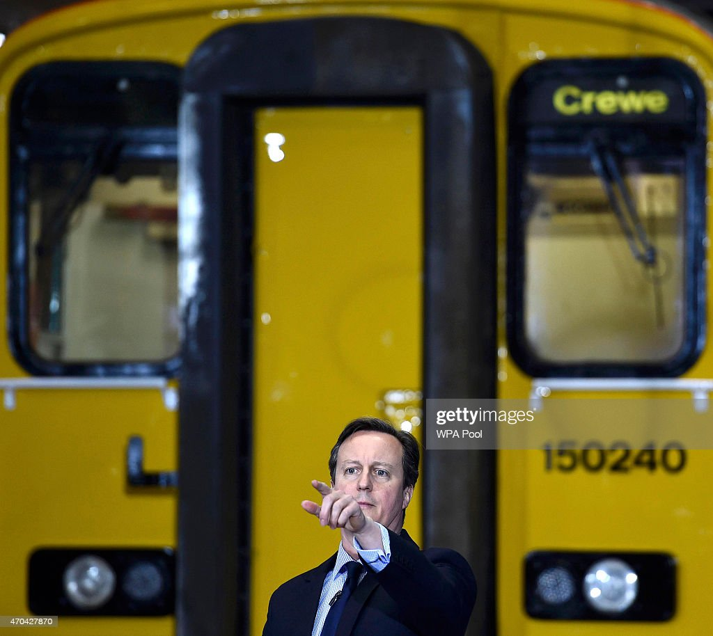 Prime Minister David Cameron addresses guests during a visit to Arriva TrainCare mantenance plant in Crewe during the fourth week of their election campaign, on April 20, 2015 in Crewe, England. Britain goes to the polls in a General Election on May 7.