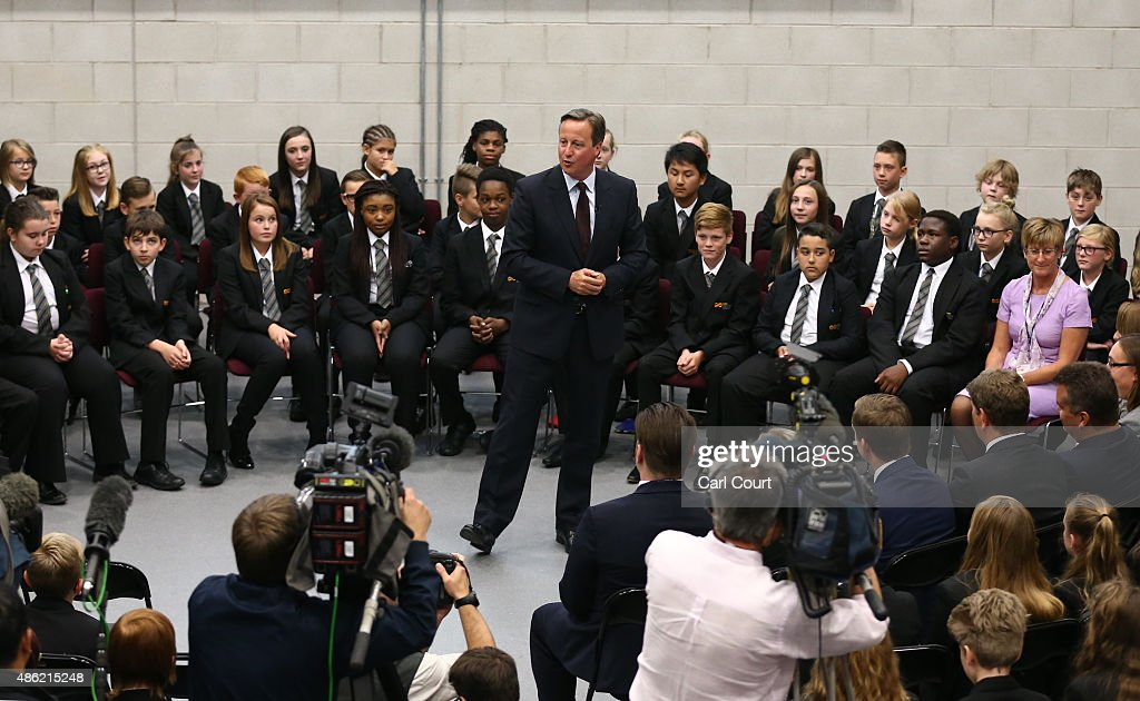 Prime Minister David Cameron addresses pupils at an assembly during a visit to Corby Technical School on September 2, 2015 in Corby, England. Mr Cameron used the visit to announce plans for another 18 free schools in England.