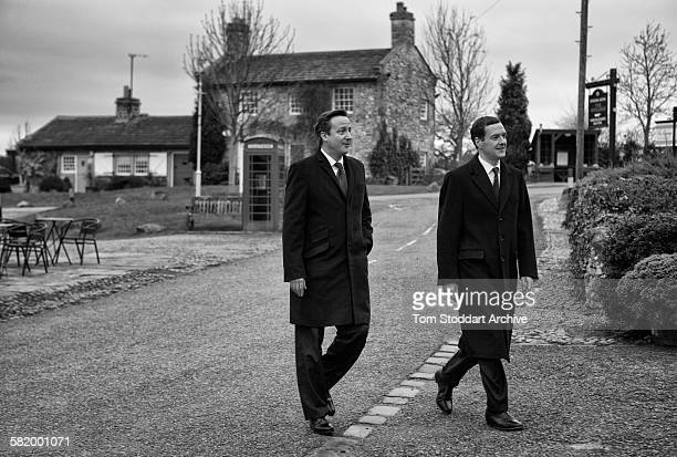 Prime Minister David Cameron and Chancellor George Osborne pictured on the set of Emmerdale Yorkshire The pair were visiting the longrunning soap to...