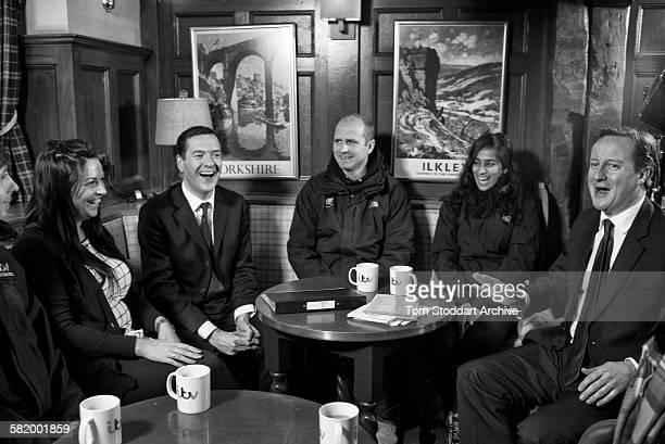 Prime Minister David Cameron and Chancellor George Osborne pictured chatting to trainees in the Woolpack pub on the set of Emmerdale Yorkshire The...