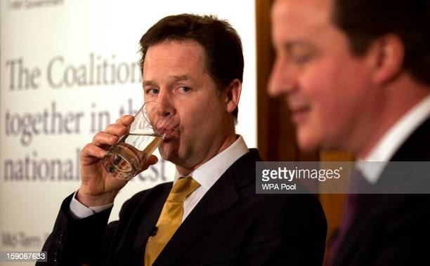 Prime Minister David Cameron and Deputy Prime Minister Nick Clegg attend a press conference at 10 Downing Street to mark the halfway point in the...