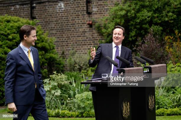 Prime Minister David Cameron and Deputy Prime Minister Nick Clegg share a joke as they hold their first joint press conference in the Downing Street...