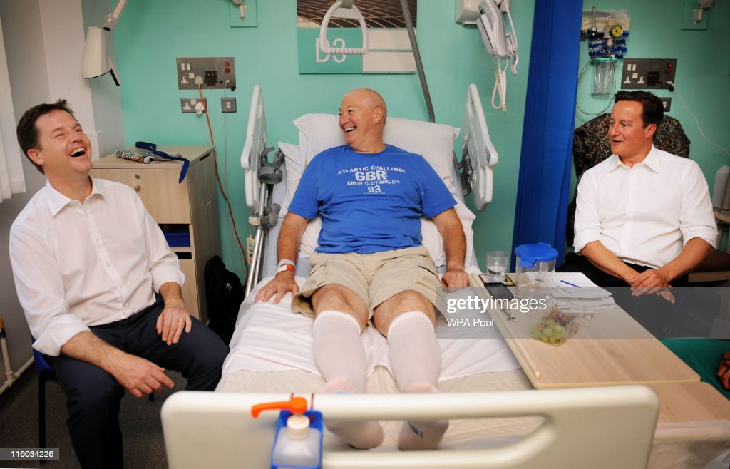 Prime Minister David Cameron (R) and Deputy Prime Minister Nick Clegg meet hip operation patient Andrew Sarton at Guy's Hospital on June 14, 2011 in London, England. The Prime Minister is today announcing changes to his controversial reforms to the National Health Service.