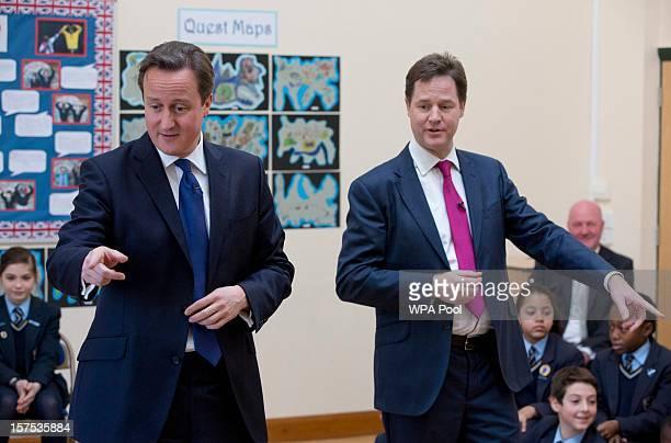 Prime Minister David Cameron and Deputy Prime Minister Nick Clegg meet children at Corpus Christi Roman Catholic Primary School on December 4 2012 in...