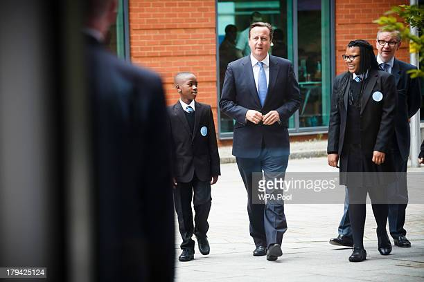 Prime Minister David Cameron and Education Secretary Michael Gove visit Perry Beeches III Free School on September 3 2013 in Birmingham England It is...