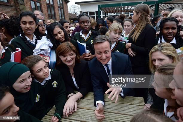 Prime Minister David Cameron and education secretary Nicky Morgan meet pupils during a visit to the Green School For Girls on March 9 2015 in London...