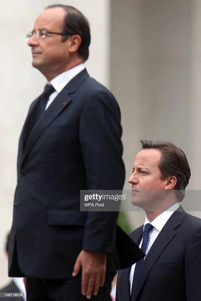 Prime Minister David Cameron (R) and French President Francois Hollande (L) stand for the French national anthem outside the Foreign and Commonwealth Office on July 10, 2012 in London, England. This is the French President's first official visit to the United Kingdom since taking office, during which he will attend meetings with British Prime Minister David Cameron and Queen Elizabeth II.