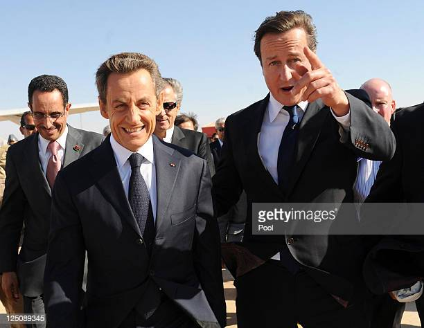 Prime Minister David Cameron and French President Nicholas Sarkozy arrive at Benghazi airport earlier today on September 15 2011 in Benghazi Libya...