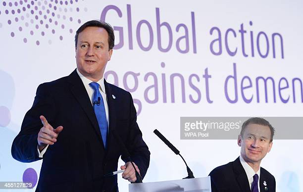 Prime Minister David Cameron and Health Secretary Jeremy Hunt attend the G8 Dementia Summit at Lancaster House on December 11 2013 in London England