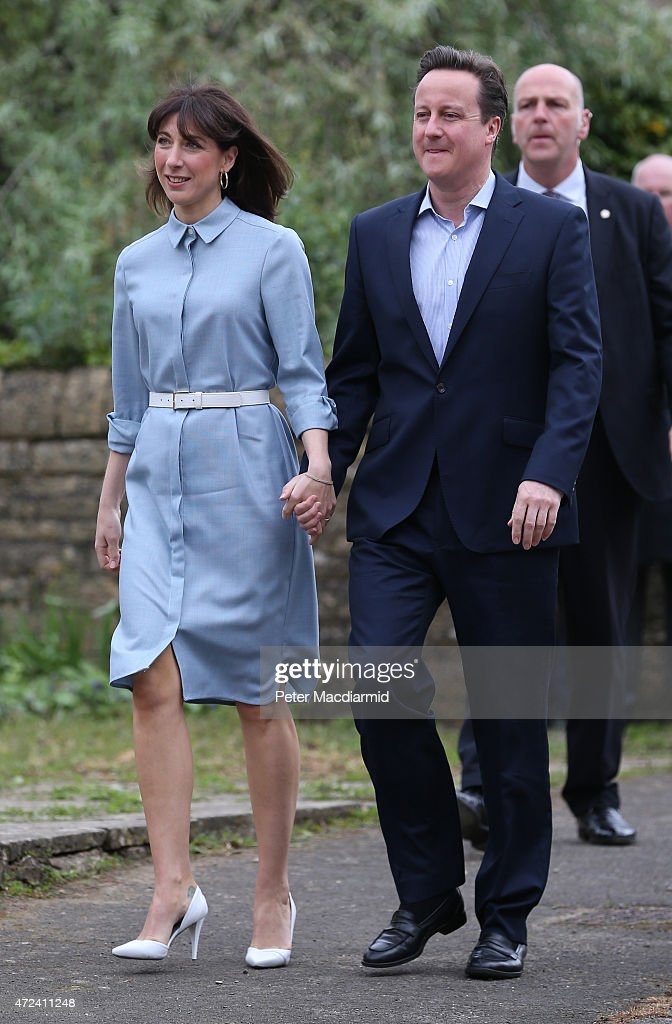 Prime Minister David Cameron and his wife Samantha arrive at a polling station to cast their vote in the general election on May 6, 2015 in Spelsbury, England. The United Kingdom has gone to the polls to vote for a new government in one of the most closely fought General Elections in recent history. With the result too close to call it is anticipated that there will be no overall clear majority winner and a coalition government will have to be formed once again.