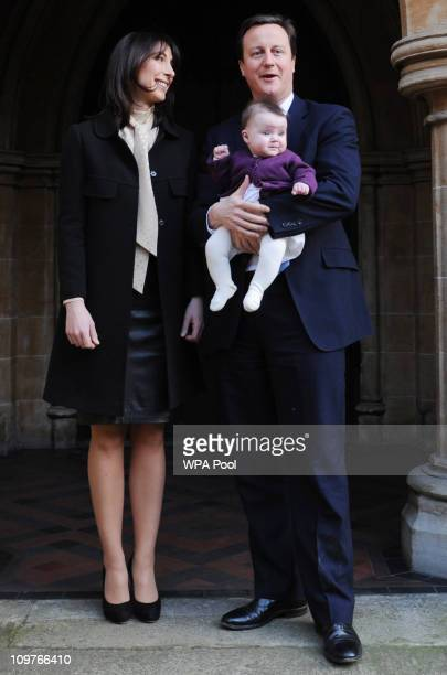 Prime Minister David Cameron and his wife Samantha Cameron after the christening of their daughter Florence Rose Endellion at St Mary Abbots Church...
