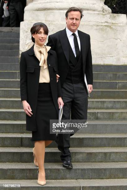 Prime Minister David Cameron and his wife Samantha Cameron leave the Ceremonial funeral of former British Prime Minister Baroness Thatcher at St...