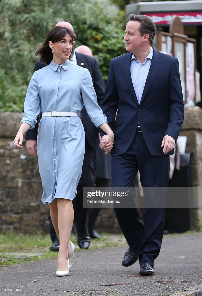 Prime Minister David Cameron and his wife Samantha holds hands as they arrive at a polling station to cast their vote in the general election on May 6, 2015 in Spelsbury, England. The United Kingdom has gone to the polls to vote for a new government in one of the most closely fought General Elections in recent history. With the result too close to call it is anticipated that there will be no overall clear majority winner and a coalition government will have to be formed once again.