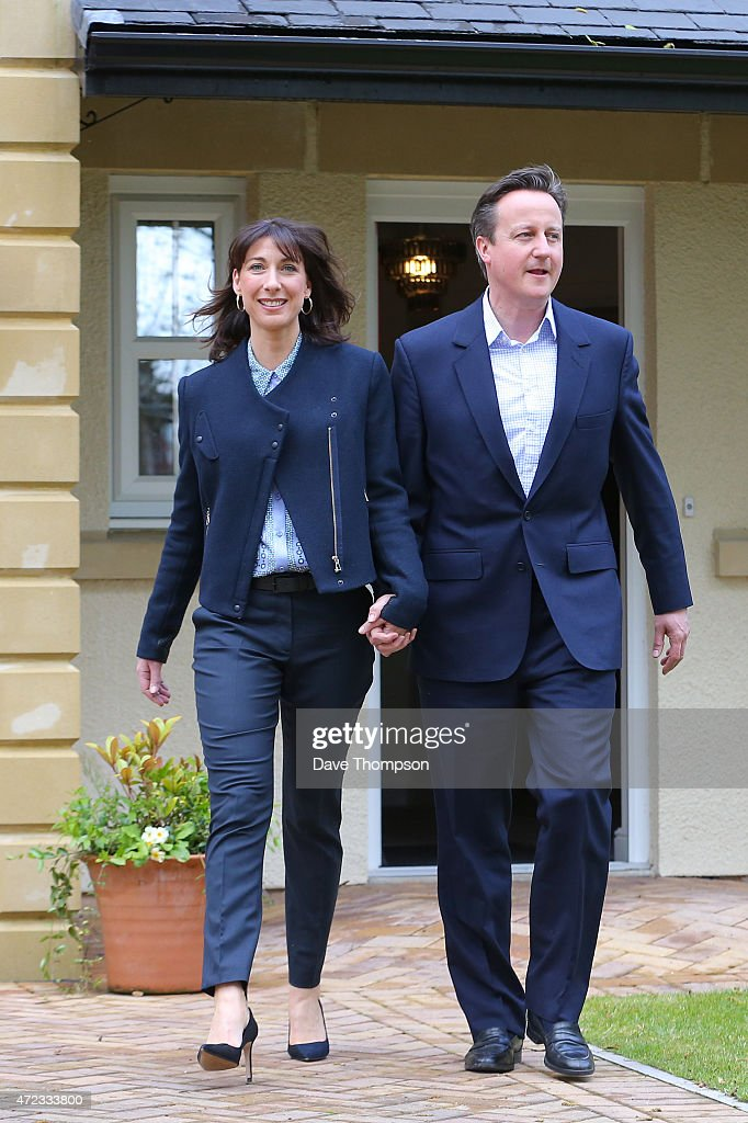Prime Minister David Cameron and his wife Samantha leave a show home during a visit to Story Homes Help to Buy development site on May 6, 2015 in Lancaster, England. Britain's political leaders are campaigning in a final day's push for votes ahead of what is predicted to be the closest General Election for a generation.