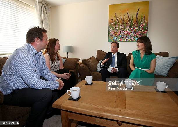 Prime Minister David Cameron and his wife Samantha meet Nicole Calver and Paul Pearson in their home on April 14 2015 in Swindon England The...