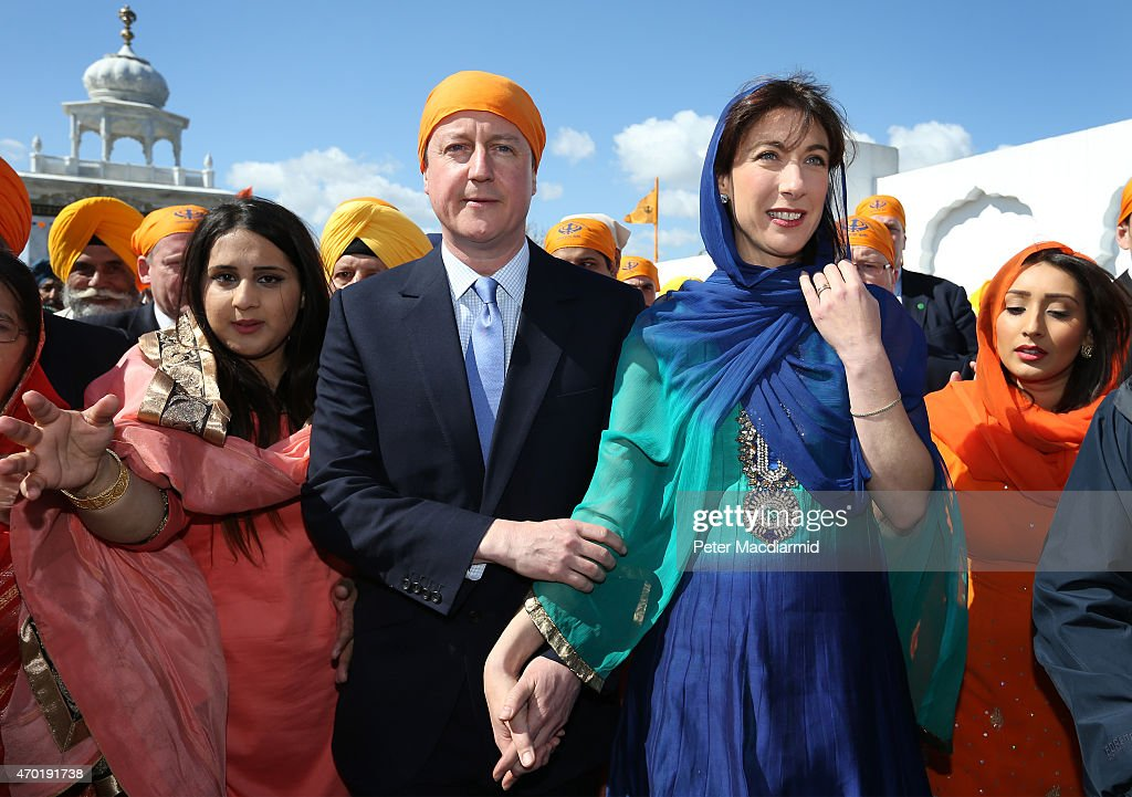Prime Minister David Cameron and his wife Samantha take part the Vaisakhi Nagar Kirtan procession at Guru Nanak Darbar Gurdwara on April 18, 2015 in Gravesend, England. The Vaisakhi Festival is the most important event in the Sikh calendar and celebrates the birth Khalsa.
