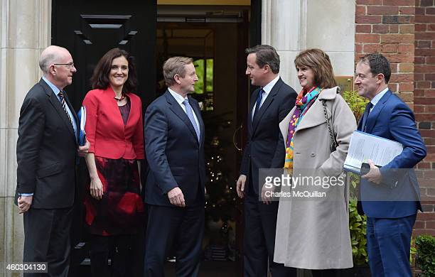 Prime Minister David Cameron and Irish Taoiseach Enda Kenny alongside Northern Ireland Secretary of State Theresa Villiers and Irish Tanaiste Joan...