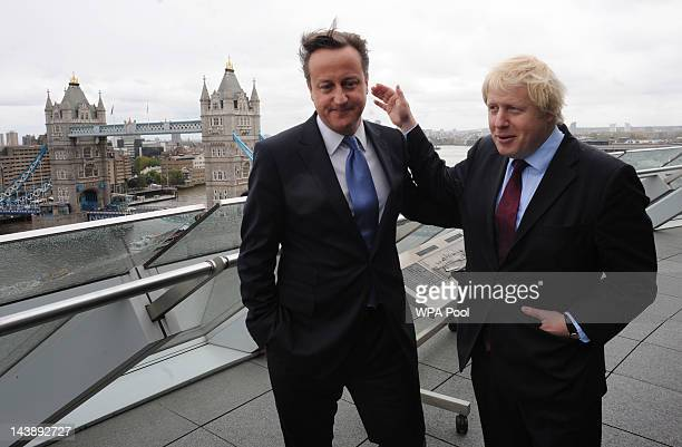 Prime Minister David Cameron and London Mayor Boris Johnson are seen following Johnson's reelection as the Mayor of London on May 5 2012 at City Hall...
