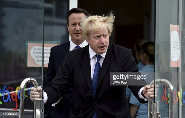 Prime Minister David Cameron and London Mayor Boris Johnson leave the Advantage children's daycare nursery on April 22 2015 in Surbiton England...