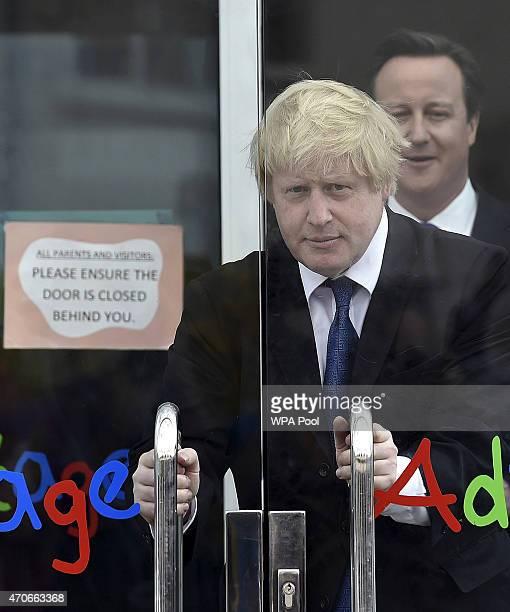 Prime Minister David Cameron and London Mayor Boris Johnson leave the Advantage children's daycare nursery on April 22 2015 in Surbiton England...