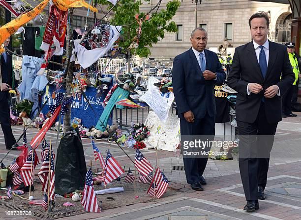 Prime Minister David Cameron and Massachusetts Governor Deval Patrick visit the memorial to the Boston Marathon bombing victims on Boylston Street on...