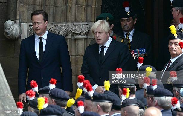 Prime Minister David Cameron and Mayor of London Boris Johnson leave Bury Parish Church following the funeral service of murdered Fusilier Lee Rigby...