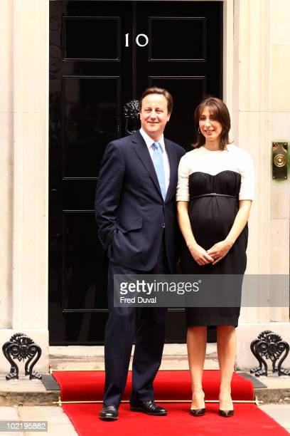 Prime Minister David Cameron and Samantha Cameron wait on the door for the arrival of French President Nicolas Sarkozy and his wife Carla...