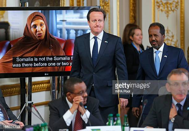 Prime Minister David Cameron and Somali President Hassan Sheikh Mohamud arrive at the Somalia conference on May 7 2013 in London England The...