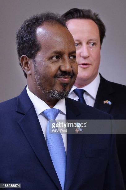 Prime Minister David Cameron and Somali President Hassan Sheikh Mohamud arrive for a press conference at the Foreign and Commonwealth Office on May 7...