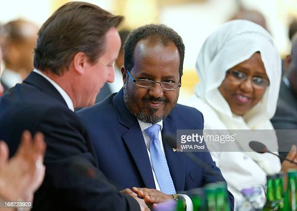 Prime Minister David Cameron and Somali President Hassan Sheikh Mohamud shake hands after making their opening speeches during the Somali conference...