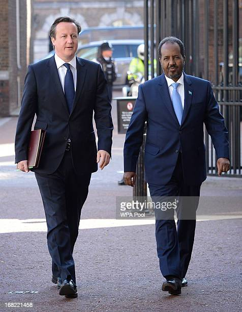 Prime Minister David Cameron arrives at the Somali conference in London with Somalian President Hassan Sheikh Mohamud on May 7 2013 in London England...