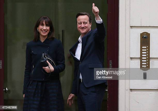 Prime Minister David Cameron arrives in London with his wife Samantha on May 8 2015 in London England After the United Kingdom went to the polls in a...
