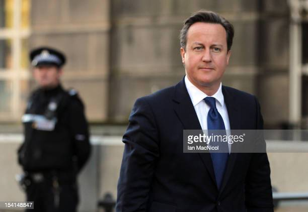 Prime Minister David Cameron arrives to meet Scottish First Minister Alex Salmond on the steps of St Andrews House prior to their meeting to set out...