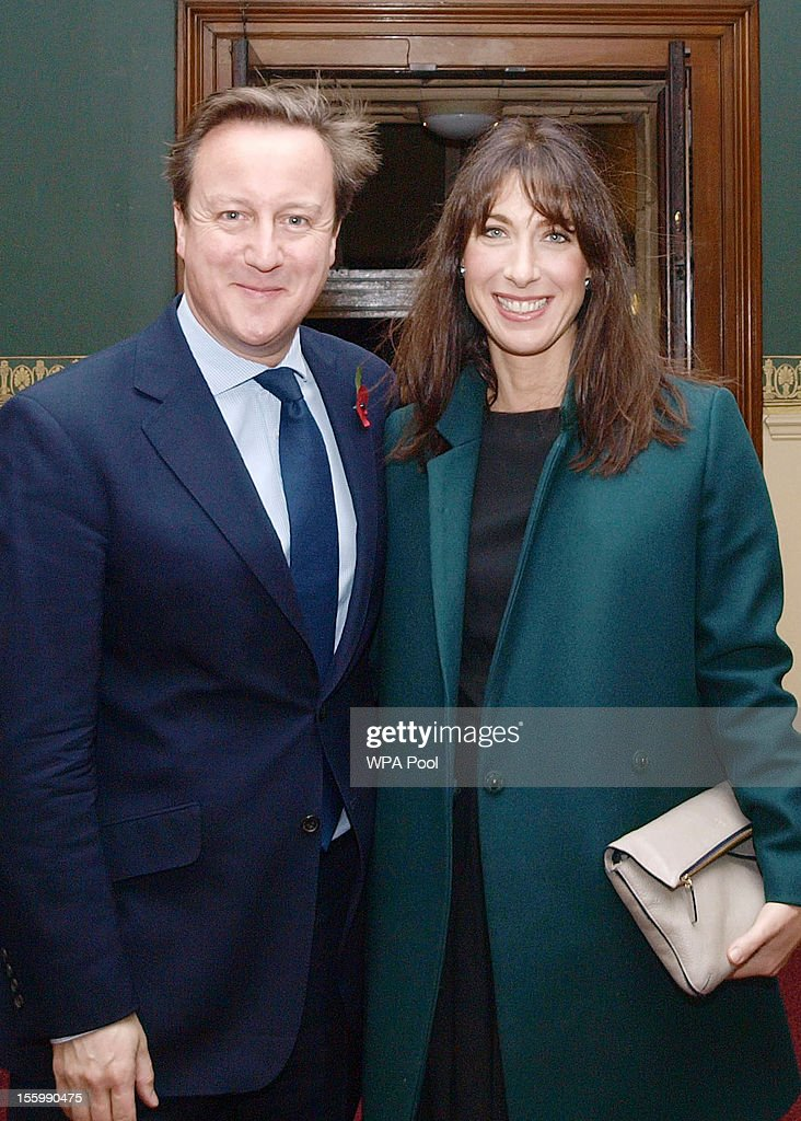 Prime Minister David Cameron arrives with his wife Samantha attend the annual Royal Festival of Remembrance, at London's Royal Albert Hall, on November 10, 2012 in London, England.