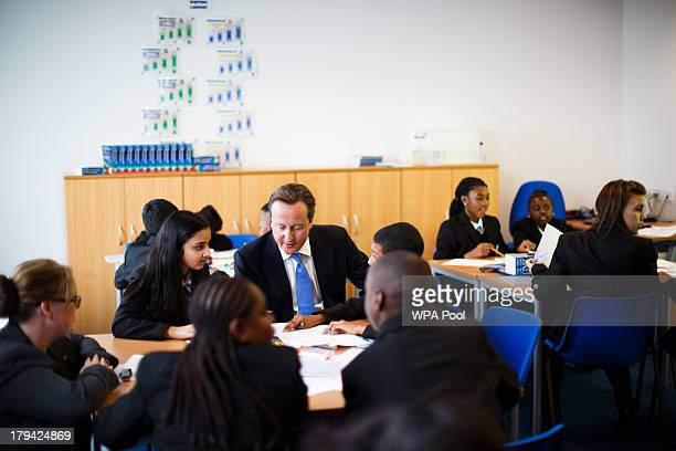 Prime Minister David Cameron attends a class as he and Education Secretary Michael Gove open Perry Beeches III Free School on September 3 2013 in...