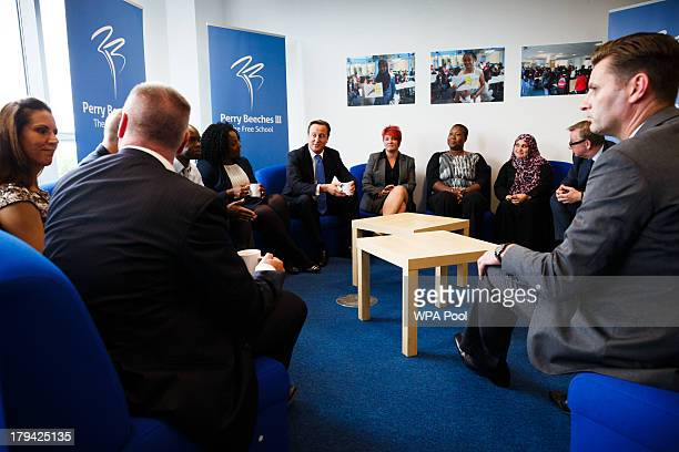 Prime Minister David Cameron attends a meeting as he and Education Secretary Michael Gove open Perry Beeches III Free School on September 3 2013 in...