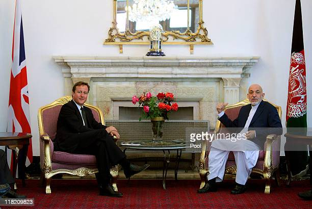 Prime Minister David Cameron attends a press conference with President of Afghanistan, Hamid Karzai, at the presidential palace on July 5, 2011 in...