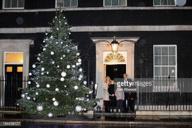 Prime Minister David Cameron Blue Peter presenter Helen Skelton and Blue Peter Badge winners turn on the Christmas tree lights at 10 Downing Street...
