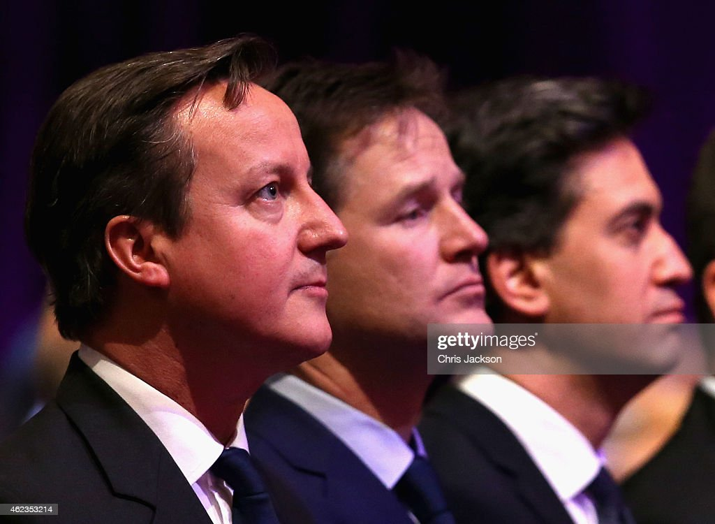 Prime Minister David Cameron, British Deputy Prime Minister Nick Clegg and Leader of the Labour Party, Ed Miliband attend a Holocaust Memorial Day ceremony at Central Hall Westminster on January 27, 2015 in London, England.