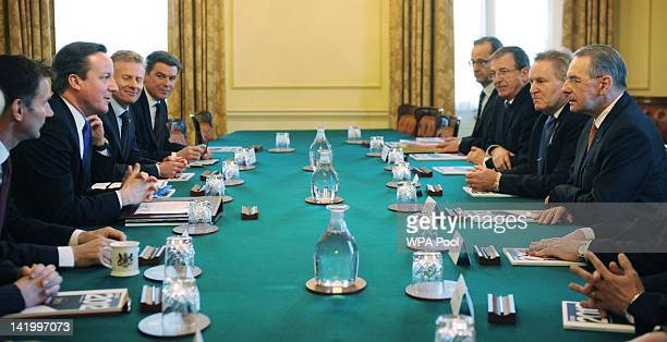 Prime Minister David Cameron chairs a meeting with IOC President Jacques Rogge IOC members IPC members and LOCOG representatives in the Cabinet Room...