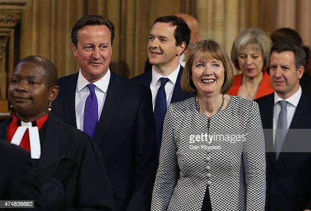 Prime Minister David Cameron Chancellor of the Exchequer George Osborne and acting leader of the Labour Party Harriet Harman process though the...