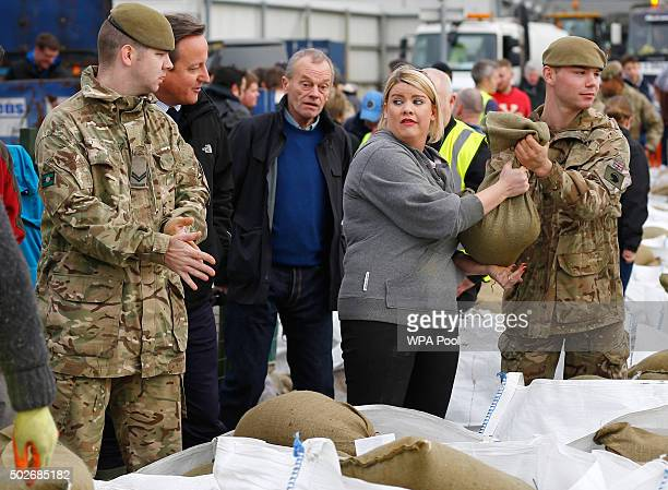 Prime Minister David Cameron chats to soldiers and volunteers filling sand bags to assist with flood relief in York city centre after the river Ouse...