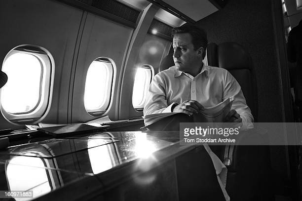 Prime Minister David Cameron deep in thought over Europe during the flight taking him to attend the G20 Summit in Cannes, France.
