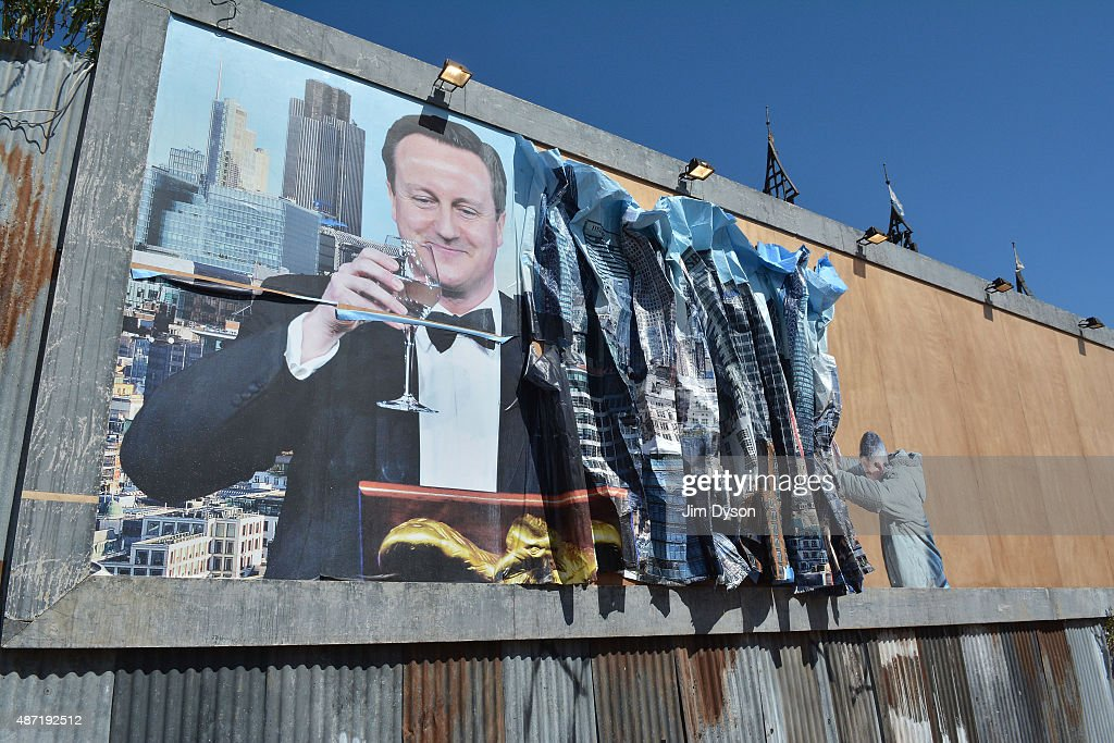 Prime Minister David Cameron features in an artwork by Peter Kennard and Cat Phillips as Banksy's Dismaland Bemusement Park opens to the public, on August 28, 2015 in Weston-Super-Mare, England. Graffiti artist Banksy has opened the subversive, pop-up theme park styled exhibition at the derelict seafront Tropicana lido, featuring the work of 50 artists. The 'Bemusement Park' combines dark humour and 'entry-level anarchism' and will open for just five weeks.